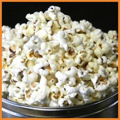 Premium White Cheddar Popcorn - Premium White Cheddar Cheese poured over baby white popcorn.  #whitecheddar #glutenfree #popcorn #chicagopopcorn #motherbutterspopcorn