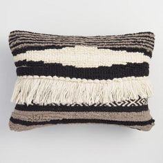 Inspired by kilim rugs, our black, white and gray lumbar pillow stuns with boho-chic stripes of woven wool and a cozy shaggy texture. With its cool neutral tones backed in black cotton, it integrates effortlessly - and stylishly - into any room.