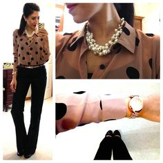 Cocoa with black polka dots blouse, black pants, pearls