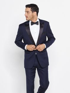 "Our midnight blue tuxedo is a daring alternative that conveys both confidence and taste. Don't worry—blue can be just as formal as black, especially paired with the classic black bowtie. Our tuxedo pants have waist adjusters up to 2"", but do not have belt loops or suspender buttons."