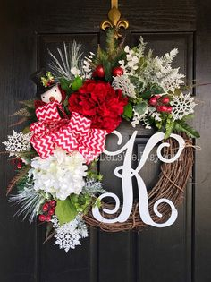 NEW ITEM!  Newest item just added to my store! This wreath is GORGEOUS and so bright and colorful!  Shown on an 18 grapevine base with moss, beautiful mixed flowing greens of ferns, ivies, evergreens, ficus leaves and more. Beautiful hydrangeas of red and white with winter red berries, mixed evergreens, white accents, red and white ornaments and an adorable snowman with snowflakes. A 12 white script monogram and a red and and white Christmas bow make up this fun and festive holiday wreath…