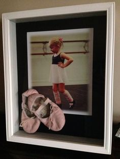 I used a shadow box with a picture from her first dance class to save her first ballet slippers. I'll add her first tap shoes later.