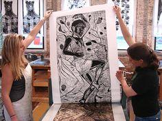 Carlye pulling woodcut from press.