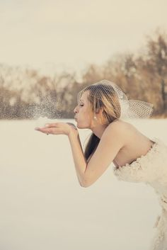 A cute picture idea for a winter bride, from @Leslie Lippi Spurlock Photography. #weddingphotography #winterbride #playful #snow