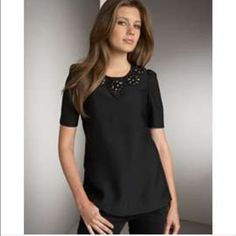 Karta jewel collar top This top is a show stopper all on its own! Black beading around collar with black shift fit and short sleeve zip back. Beads are a bit heavy but shirt wears beautifully. Karta Tops Blouses