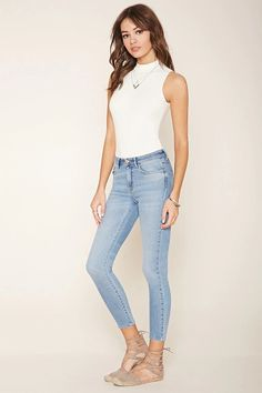 A pair of woven skinny jeans featuring a low-rise design, a five-pocket construction, and a zip fly. #f21denim