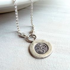 Om Necklace, Ohm Necklace, Yoga Jewelry, Sterling Silver Yoga Charm, Sterling Silver Charm Necklace. $35.00, via Etsy.