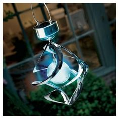 Solar Wind Spinner Light Great to watch spinning during the daytime and changes into a spectuclar colour changing light after dark making it a great garden feature.