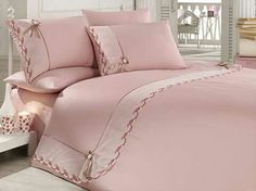 Linen satin * beautifully decorated with edged pink linen .