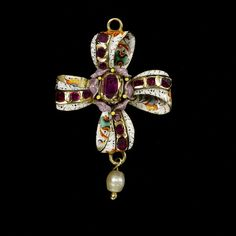 Europe (West), ca. 1630-1660 Enamelled gold set with rubies and hung with a pearl