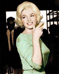 Marilyn Monroe. Colourized photo of MM at a press conference at the Hilton Hotel in Mexico City, February 22nd 1962. She is wearing the famous green Pucci gown in which she was laid to rest ♥