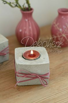 A good idea to dress up a concrete candle holder for a gift.