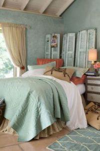 large tile floor, teal on walls/rug, gray bed, cedar furniture