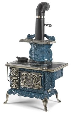 The Favorite Stove & Range Company cast iron and nickel Dolly's Favorite salesman sample stove, 23'' h., 18 1/2'' w.