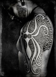 Peter Madsen creates an abstract octopus tattoo with sacred geometry designs. Like many of of Madsen's tattoos designs, this art work is both both and intricately detailed.