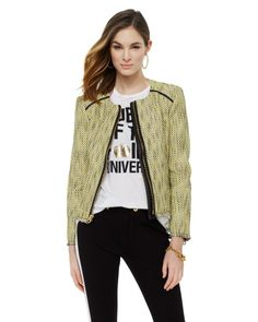 We're definitely not lugging around 10 full outfits for a quick weekend getaway, so we're relying on statement outerwear to take simple basics from zero to 60. A classic silhouette with edgy leather trim, this light-yellow topper fits the bill.   Juicy Couture Tweed Jacket, $268, available at Juicy Couture.