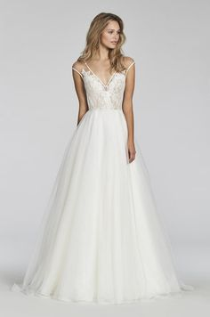 Style 1703 Val - Ivory lace and organza A-line bridal gown, V-neck bodice and illusion cap sleeve, keyhole back with delicate trim accent, pleated circular organza skirt.