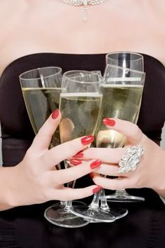 Champagne, a black dress and red nails never go out of style.