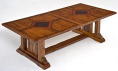 Our elegant rustic barn wood table adds a majestic hint of craftsman talent to this homestead dining experience. This table is made from century old barn wood that has been carefully restored to a beauty, far above its old use. The base uses its massive three legs and cross floor trestle to support the hefty