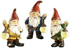"""Gift Craft 14.8-Inch Poly Resin Gnome Statues with Glow in The Dark Glass Lanterns, Medium by Gift Craft. $141.91. Durable polyresin construction. Outdoor safe. Lights up to create a beautiful outdoor ambiance. Add a touch of enchanting charm and a soft glow of light to any outdoor setting with this set of three garden gnome statues holding glow-in-the-dark lanterns. the collection features three unique designs with rustic woodland finishes. measures approximately 7.9""""-9.5"""" x 6..."""