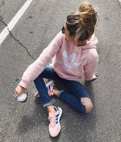 Comfy casual style in pink adidas hoodie and distressed denim