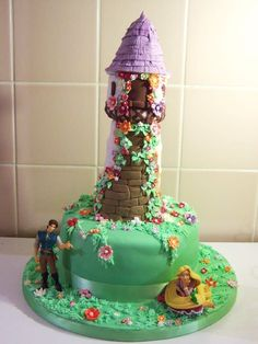 I made this for my Daughter she loves Repunzel! the tower is all cake. The Characters were bought from the Disney shop for a present for after the cake had been eaten.