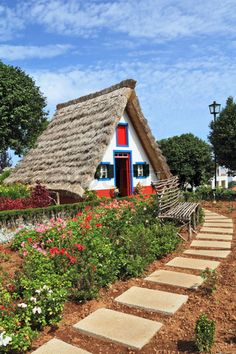 Madeira Island, the city Santana Cosy chalet with a triangular thatched roof Before the house - garden with beautiful flower beds and paths