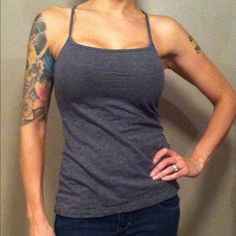 "Garage Racer Back Tank Very soft, comfy, stretchy, medium gray in color, racer back tank with thin straps. Measurements are taken with item laying down  flat and are approximate, but I try my best. Length 24.15"" (top of strap to bottom hem), bust 12.75"". Machine washable with cold water 95% cotton, 5% spandex. Garage Tops Tank Tops"