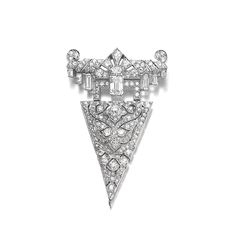 Diamond brooch/pendant, Cartier, 1920s. Of geometric and foliate design, set with variously cut diamonds, suspending a hinged triangular plaque.