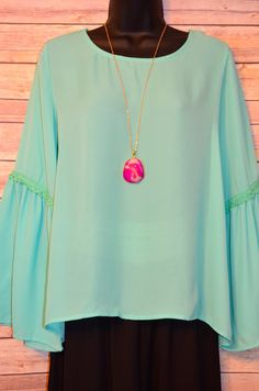 Sassy Side Top from The Charming Arrow Boutique