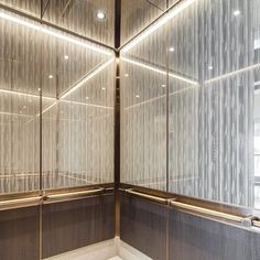 A winning combo → ViviGraphix Graphica glass with bronze accents in a variety of F+S materials. Design by @tvsdesign . . . #elevator #elevatorinterior #interiordesign #interiorstyle #architectural #surfaces #hoteldesign