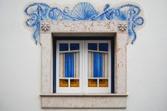 Ericeira, Portugal ~ lovely window in blue and golds with gorgeous painted design