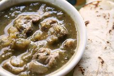 Chile Verde ~ Authentic Mexican pork chile verde recipe, with chunks of pork shoulder slow cooked in a roasted tomatillo and jalapeno chile verde sauce. So good! ~ SimplyRecipes.com