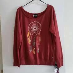 Dreamcatcher Sweatshirt Rust colored sweatshirt with dreamcatcher on front, nwt Size : XL 60% cotton/40% polyester Machine wash/Tumble dry L.A. Kitty Sweaters Crew & Scoop Necks