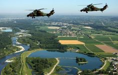 Pair of French Armée de Terre Eurocopter Tigre, attack helicopters flying over the area of ​​Pau June 24, 2009.
