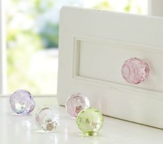 Change out knobs.....What a difference a gorgeous knob makes....adorable dresser knobs! ($22) PBkids