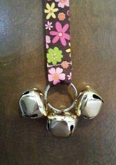 Flowery doggie door bells. https://www.etsy.com/listing/178167426/door-bells-for-your-doggie-brown-with