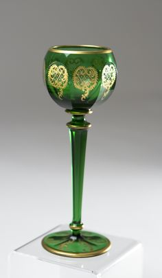 Set of 12 Moser 19th c. emerald green wine goblets with raised paste gold decoration   Elise Abrams Antiques