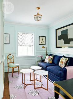 Because none of us here at Apartment Therapy are fabulously wealthy (I know, you're shocked) we love it when decorators mix inexpensive pieces into high-end interiors
