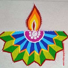 Creative rangoli designs Perfect For Sprucing Diwali Rangoli designs 2019 are about incorporating flowers in them. Flower wedding rangolis have gained much popularity this wedding season. Rangoli Designs Simple Diwali, Easy Rangoli Designs Diwali, Rangoli Simple, Indian Rangoli Designs, Rangoli Designs Latest, Rangoli Designs Flower, Free Hand Rangoli Design, Rangoli Border Designs, Small Rangoli Design