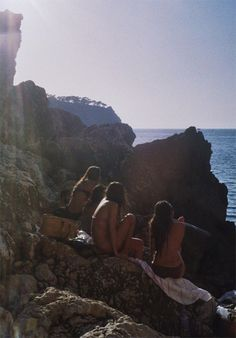 QUENTIN DE BRIEY: 10 X 15. women, ocean, sea, swimming, outdoors, nature, rocks, summer, friendship, waiting, bikini, sky,