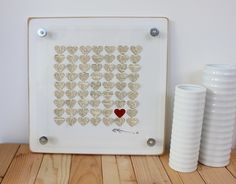 Custom Anniversary or Wedding Gift Frame:  Vintage Dictionary Framed 3D hearts  (Hearts are cut from a 1928 dictionary). $85.00, via Etsy.