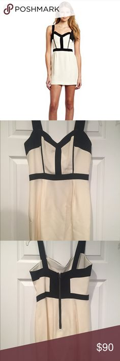 Rebecca Minkoff M Bustier Dress Woven silk with contrast panel trim at bodice. Tonal top stitching. Built-in boning. Exposed back zip with hook and eye closure. Fully lined. 100% silk. Cream and black. Rebecca Minkoff Dresses Mini