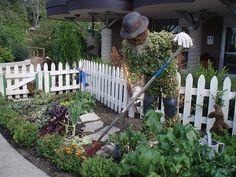 garden sculpture. living scarecrow.