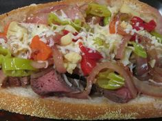 "SIRLOIN-ONION-GIARDINIERA HOAGIE  Senior says this is the best sandwich ever (I think I've heard that before). Of course, one of his recent dinners was a salad he deemed ""too green,"" so anything overflowing with meat was bound to earn a gold star. The only complaint came from Junior Too who, to my surprise, said there was no way he could eat the whole thing. But he did–and a piece of pie :)"