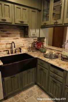 love the bottom center hardware, the color cabinets, backsplash, and FARM SINK is to die for.