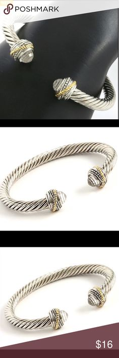 Created White Topaz Cable Bracelet 2.65ctw Created White Topaz Two Tone Cable Bracelet. Two Tone 14k Gold plated over high end jewelry Alloy. These are stock photos. Actual photos to be uploaded shortly. Jewelry Bracelets
