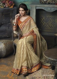 Brasso material gold & orange color saree with broad border patta