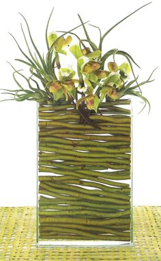 Cut willow branches as vase filler for contemporary flower vase.