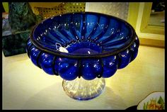 Great Blown Glass Pedistal Bowl with a clear pedistal and colbalt blue glass top trimed out in a black iron metal...gotta love it!